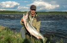 Jan Johansson with a salmon on 12,5 kg light in Torneåälv.
